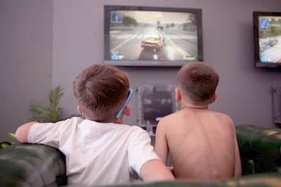 playing video games with gaming console connected to tv